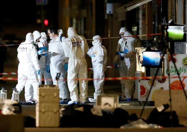 Forensic officers inspect the site of a suspected bomb attack in central Lyon, France May 24, 2019