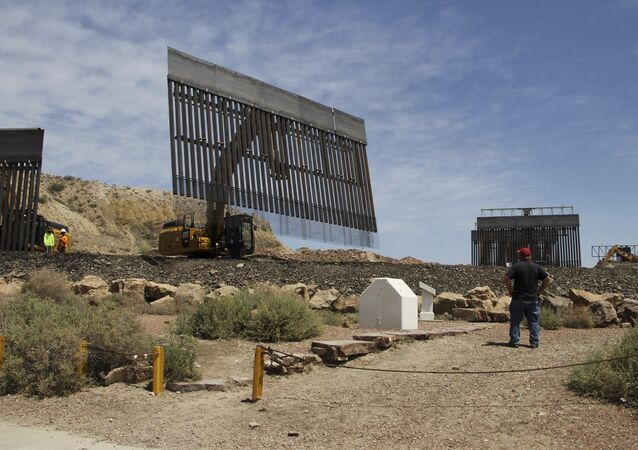 Workers build a border fence in a private property located in the limits of the US States of Texas and New Mexico taken from Ciudad Juarez, Chihuahua state, Mexico on May 26, 2019.