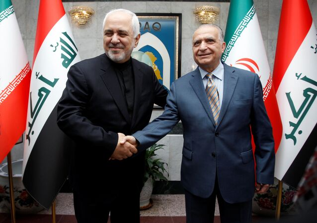 Iranian Foreign Minister, Mohammad Javad Zarif, shakes hands with Iraqi Foreign Minister Mohamed Ali Alhakim in Baghdad, Iraq May 26, 2019