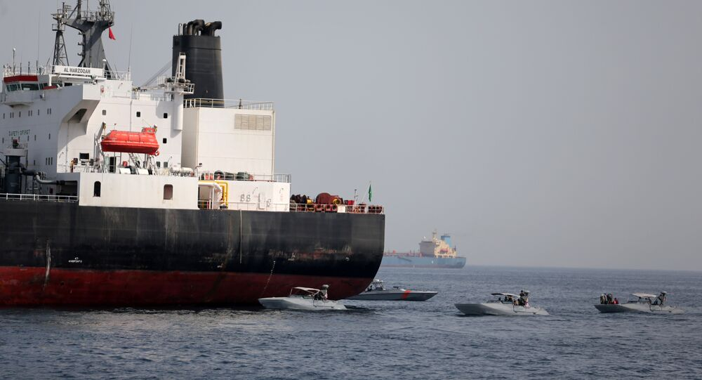 UAE Navy boats are seen next to the Saudi tanker Al Marzoqah off the Port of Fujairah, UAE, May 13, 2019