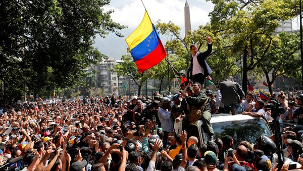 Venezuelan opposition leader Juan Guaido, who many nations have recognised as the country's rightful interim ruler, gestures after talking to supporters in Caracas, Venezuela April 30, 2019 - Sputnik International