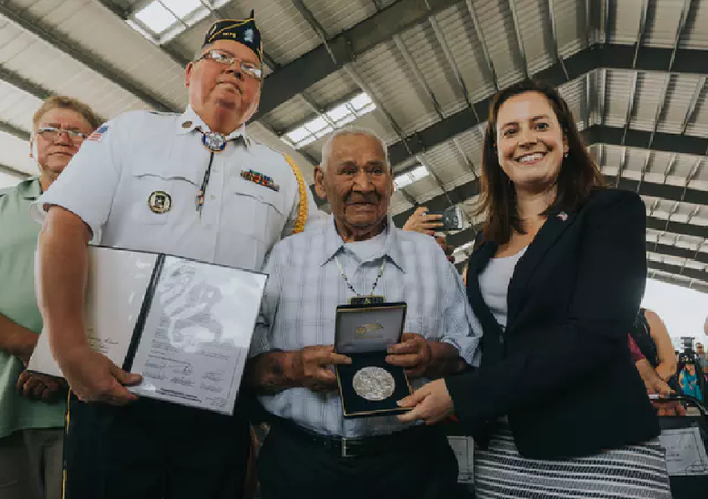 Akwesasne Mohawk Code Talker Louis Levi Oakes receiving the Congressional Silver Medal from U.S. Congresswoman Elise Stefanick (NY-21) and American Legion Post #1479 Commander Michael Goon Cook on Onerahtohkó:wa/May 28, 2016