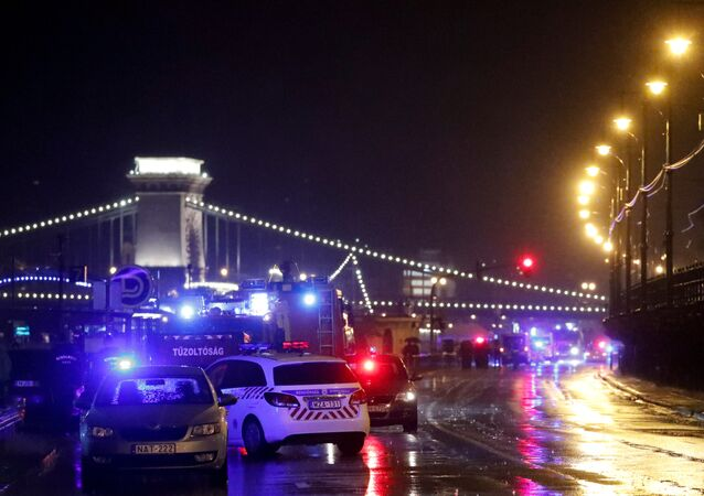 Police and fire brigade vehicles are seen on the Danube bank after tourist boat capsized on the river in Budapest, Hungary, May 29, 2019.