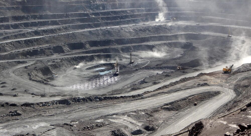 Miners are seen at the Bayan Obo mine containing rare earth minerals, in Inner Mongolia, China July 16, 2011