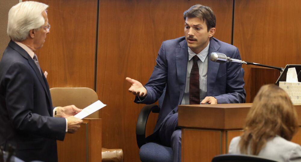 Daniel Nardoni, defence attorney, questions actor Ashton Kutcher at the murder trial of accused serial killer Michael Thomas Gargiulo in Los Angeles, California, U.S., May 29, 2019