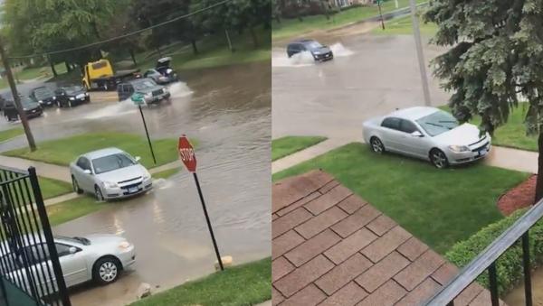 Off the Flooded Path: Chicago Motorist's Unconventional Detour - Sputnik International