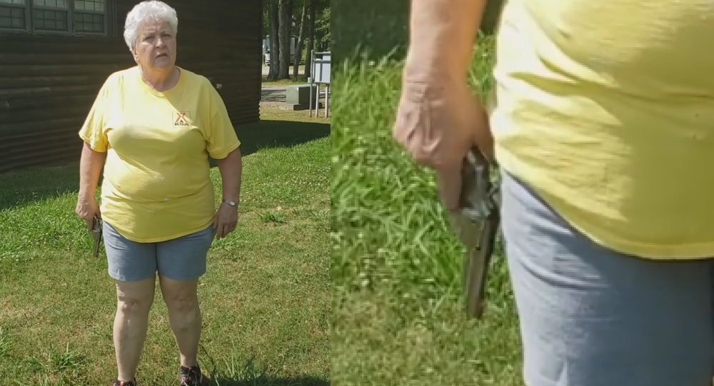 Elderly woman wielding a revolver confronts a couple attempting to have a picnic