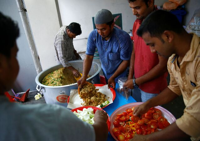 Migrant workers prepare food ahead of Eid al-Fitr, or Festival of Breaking the Fast, which marks the end of the holy month of Ramadan