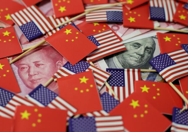 A U.S. dollar banknote featuring American founding father Benjamin Franklin and a China's yuan banknote featuring late Chinese chairman Mao Zedong among U.S. and Chinese flags in this illustration picture taken May 20, 2019. Picture taken May 20, 2019