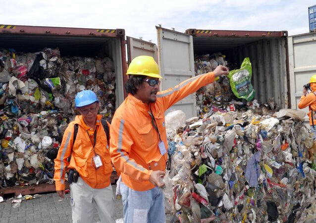 Philippine customs officials inspect cargo containers containing tonnes of garbage shipped by Canada at Manila port November 10, 2014