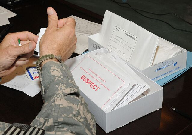 Medical professionals learn how to use the Sexual Assault Evidence Collection kit at Camp Phoenix near Kabul, Afghanistan, Aug. 15, 2010. The kit has several packets to collect evidence from a suspect and a patient of a sexual assault case.