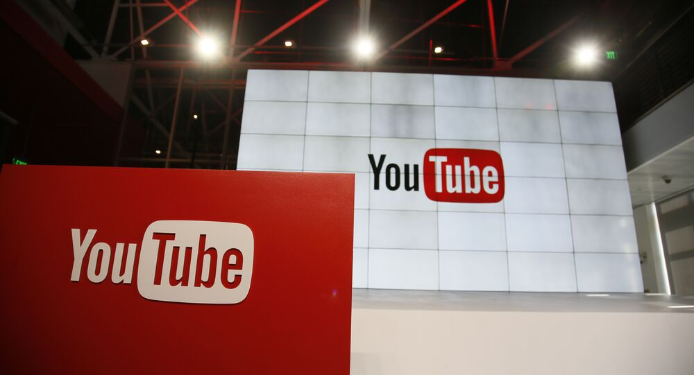 This Oct. 21, 2015, file photo shows signage inside the YouTube Space LA offices in Los Angeles. YouTube's inability to keep ads off unsavory videos is threatening to transform a rising star in Google's digital family into a problem child. The key question is whether a recently launched ad boycott of YouTube turns out to be short-lived or the start of a long-term marketing shift away that undercuts Google's growth, as well as Alphabet Inc., its corporate parent.
