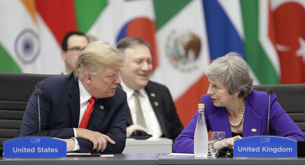 Britain's Prime Minister Theresa May, right, listens to President Donald Trump during the G20 summit in Buenos Aires, Argentina, Friday, Nov. 30, 2018.