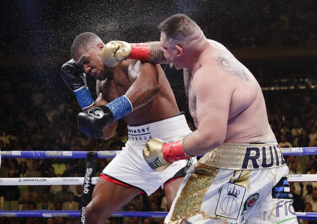 Andy Ruiz, right, punches Anthony Joshua during the seventh round of a heavyweight championship boxing match Saturday, June 1, 2019, in New York. Ruiz won in the seventh round