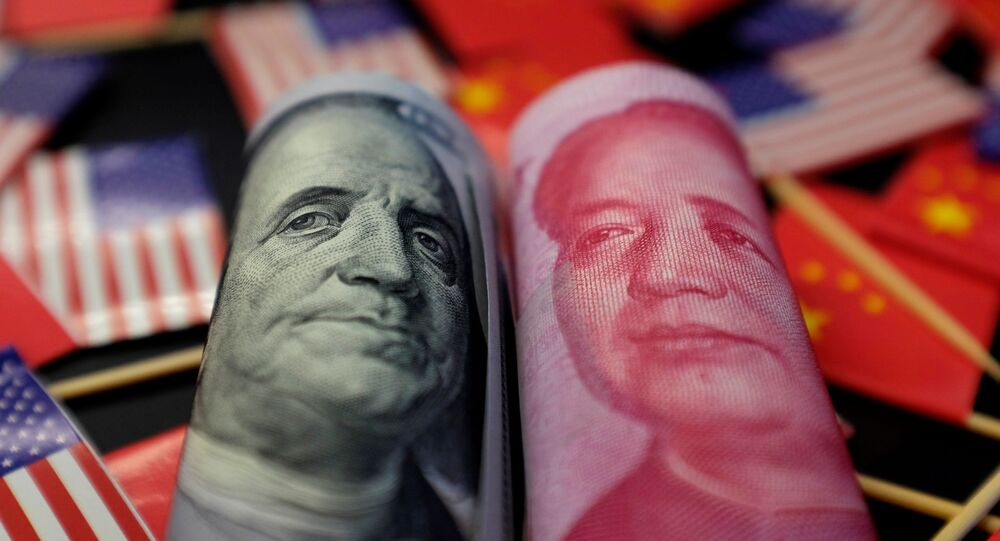 A U.S. dollar banknote featuring American founding father Benjamin Franklin and a China's yuan banknote featuring late Chinese chairman Mao Zedong are seen among U.S. and Chinese flags in this illustration picture taken May 20, 2019. Picture taken May 20, 2019