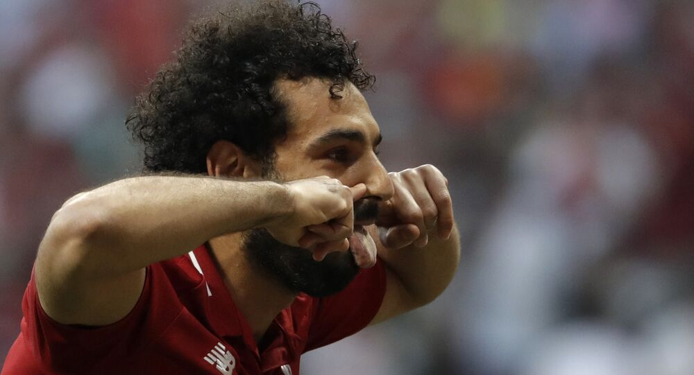 Liverpool's Mohamed Salah celebrates after scoring his side's opening goal during the Champions League final soccer match between Tottenham Hotspur and Liverpool at the Wanda Metropolitano Stadium in Madrid, Saturday, June 1, 2019.