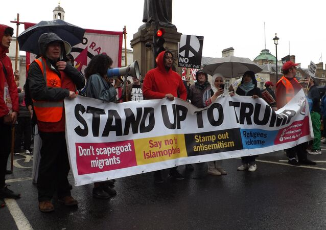 People march through London's streets to protest against Donald Trump visit