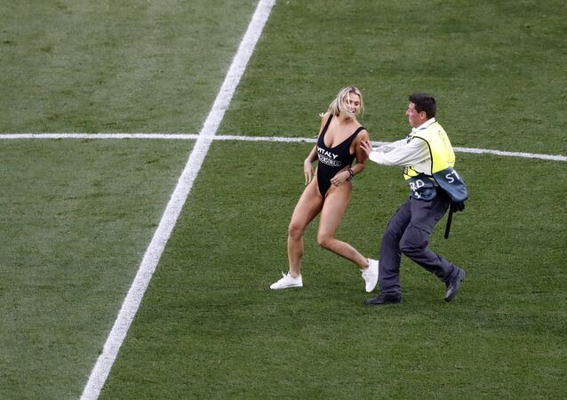 A pitch invader interrupts the game during the Champions League final soccer match between Tottenham Hotspur and Liverpool at the Wanda Metropolitano Stadium in Madrid, Saturday, June 1, 2019