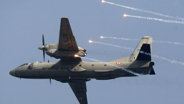 Indian Air Force's (IAF) AN-32 transport aircraft releases flares as it flies past at the IAF Day Parade in New Delhi, India, Thursday, Oct. 8, 2009. The IAF is celebrating its 77th anniversary today - Sputnik International