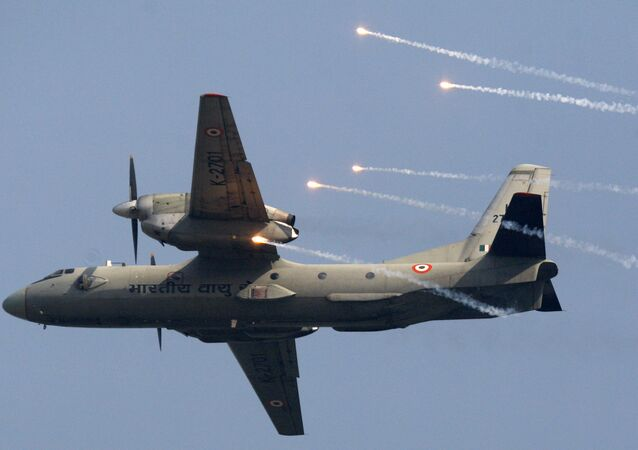 Indian Air Force's (IAF) AN-32 transport aircraft releases flares as it flies past at the IAF Day Parade in New Delhi, India, Thursday, Oct. 8, 2009. The IAF is celebrating its 77th anniversary today