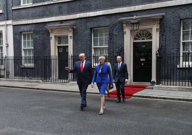 Britain's Prime Minister Theresa May, her husband Philip May, right, President Donald Trump and first lady Melania Trump, second right, walk from 10 Downing Street to the Foreign Office for a joint press conference in central London, Tuesday, June 4, 2019