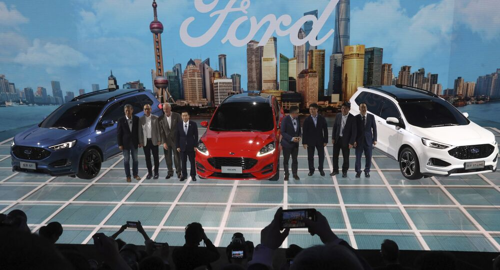 Executives and guests gather for a group photo at the Ford booth during the Auto Shanghai 2019 show in Shanghai Tuesday, April 16, 2019
