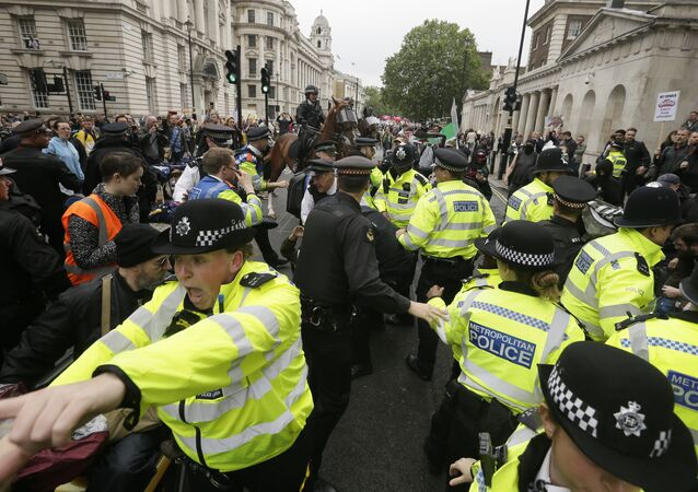 Police forces are trying to restore order after a small scuffle broke out between Donald Trump supporters and people that gathered in central London to demonstrate against the state visit of President Donald Trump, Tuesday, June 4, 2019
