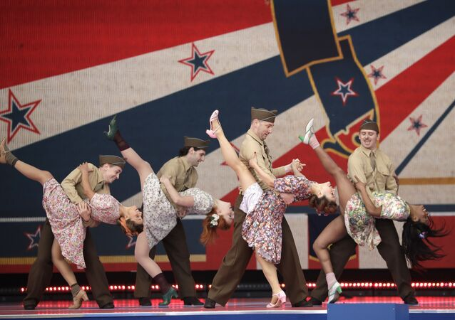 Dancers in period costume perform during an event to mark the 75th anniversary of D-Day in Portsmouth, England Wednesday, June 5, 2019