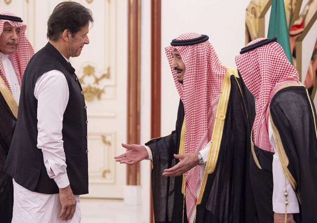 This handout photo released by the Saudi Royal Palace shows King Salman bin Abdulaziz (C) of Saudi Arabia welcoming Pakistani Prime Minister Imran Khan (L) at the opening session of a summit of the 57-member Organization of Islamic Cooperation (OIC) in the Saudi holy city of Mecca in the early hours of June 1, 2019