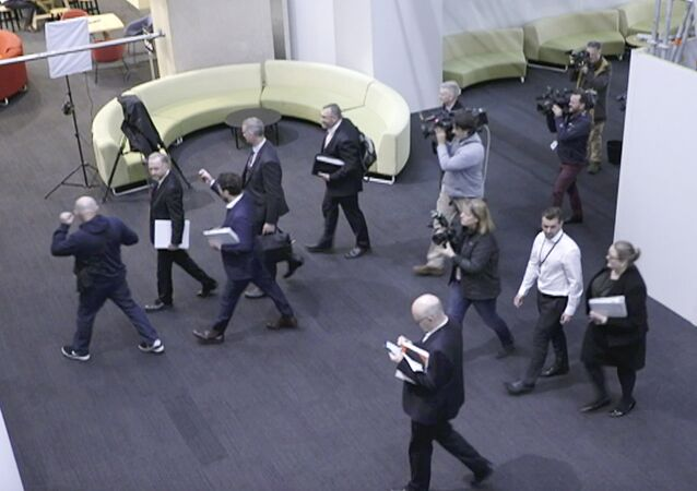 In this image made from video, Australia's Federal Police, top, enter the Australian Broadcasting Corporation, the national public broadcaster, during a raid on their offices in Sydney, Australia