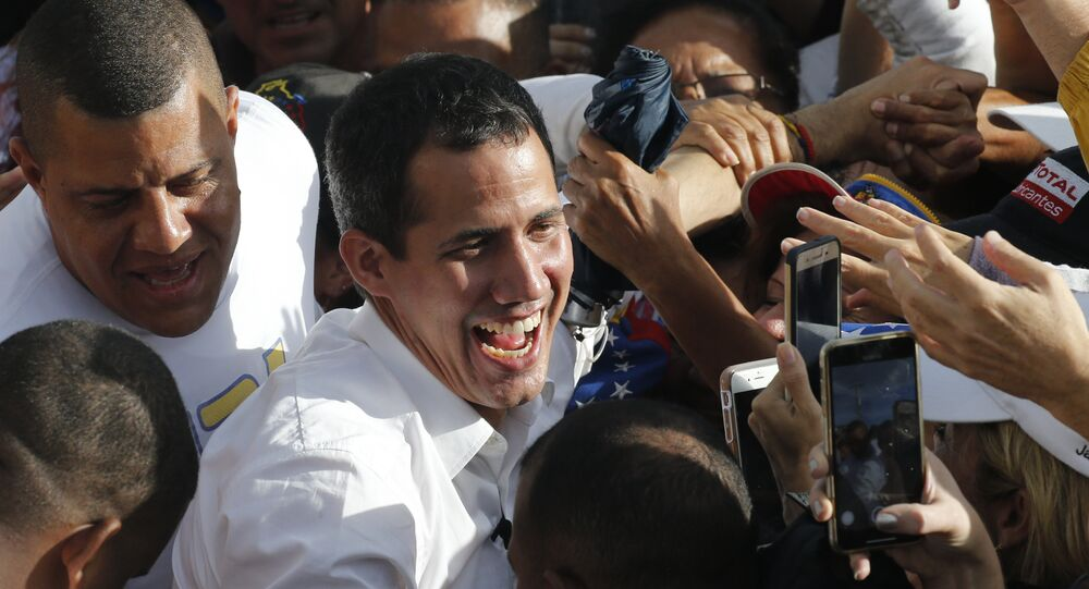 Venezuela's opposition leader and self-proclaimed interim president Juan Guaido greets supporters during a rally in Barinas, Venezuela, Saturday, June 1, 2019. Guaido is taking his campaign to oust President Nicolas Maduro to the birthplace of Hugo Chavez, the socialist leaders's mentor