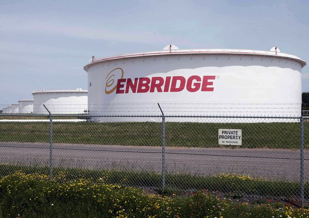 This June 29, 2018 photo shows tanks at the Enbridge Energy terminal in Superior, Wis. Enbridge Energy is delaying the startup of its planned Line 3 replacement crude oil pipeline through northern Minnesota by a year.