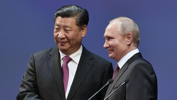 Russian President Vladimir Putin and Chinese leader Xi Jinping - Sputnik International
