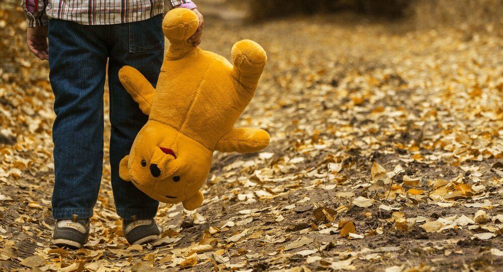Child with a teddy bear