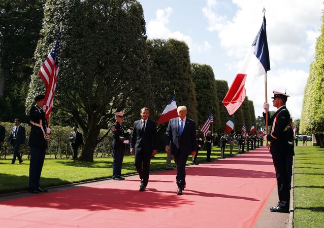 President Donald Trump and French President Emmanuel Macron, arrive to a ceremony to commemorate the 75th anniversary of D-Day at The Normandy American Cemetery, Thursday, June 6, 2019, in Colleville-sur-Mer, Normandy, France