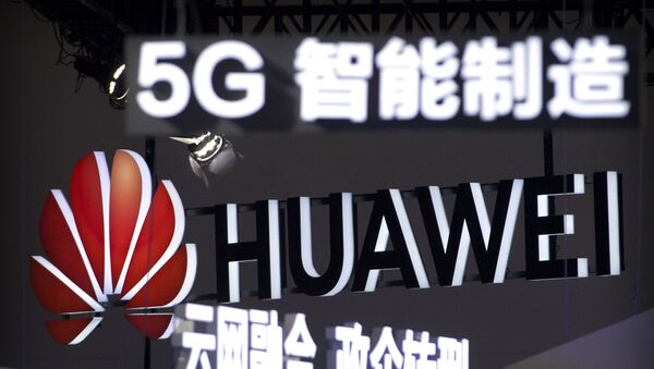 In this Sept. 26, 2018, photo, signs promoting 5G wireless technology from Chinese technology firm Huawei are displayed at the PT Expo in Beijing. A spy chief said in a speech released Tuesday, Oct. 30, 2018 - Sputnik International
