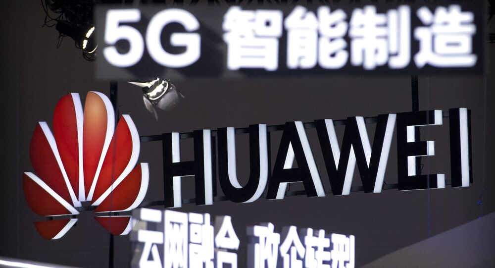 In this 26 September 2018 photo, signs promoting 5G wireless technology from the Chinese technology firm Huawei are displayed at the PT Expo in Beijing.