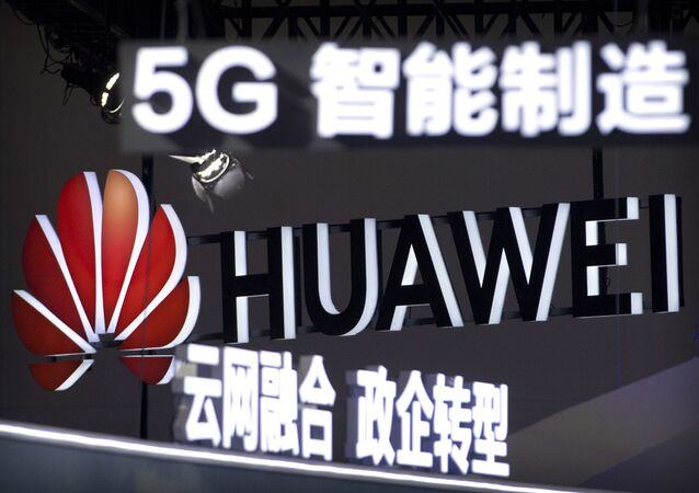 In this Sept. 26, 2018, photo, signs promoting 5G wireless technology from Chinese technology firm Huawei are displayed at the PT Expo in Beijing. A spy chief said in a speech released Tuesday, Oct. 30, 2018
