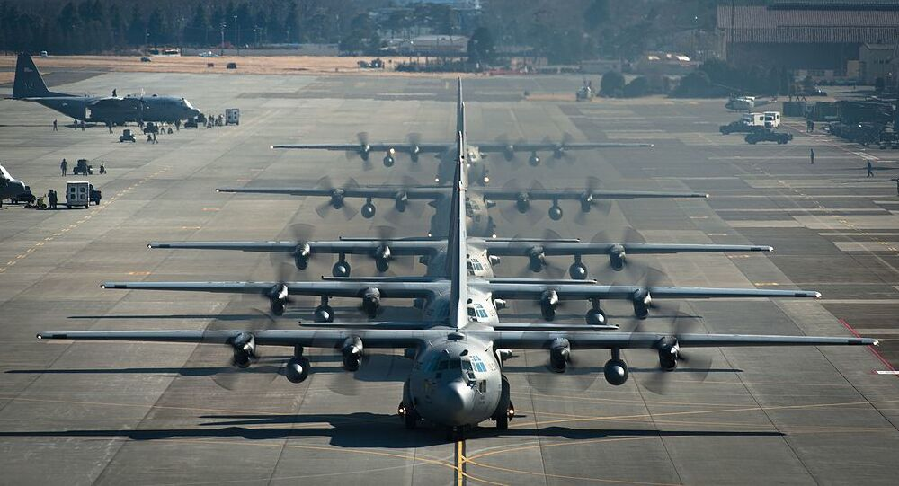 Six U.S. Air Force C-130 Hercules aircraft assigned to the 374th Airlift Wing line up before flying during a readiness week Feb. 21, 2013, at Yokota Air Base, Japan
