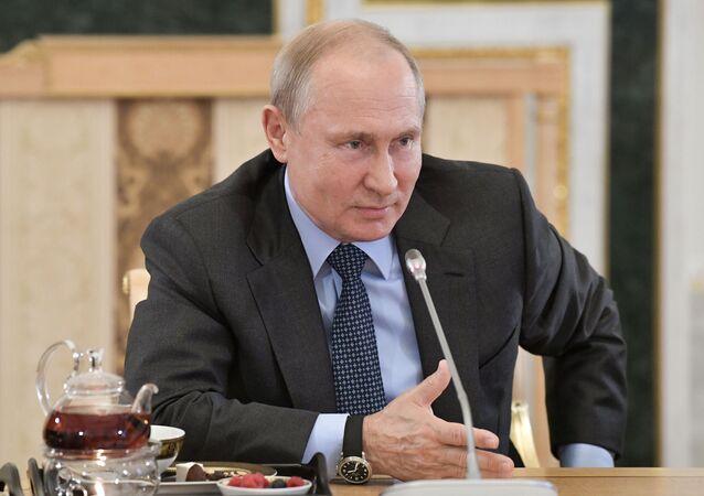 Russian President Vladimir Putin meets representatives of global news agencies