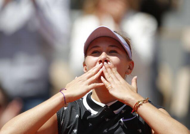 Amanda Anisimova of the US celebrates after her quarterfinal match against Romania's Simona Halep