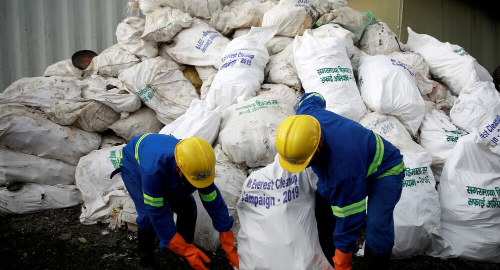 Workers from a recycling company load the garbage collected and brought from Mount Everest in Kathmandu