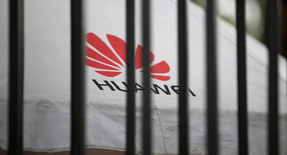 A Huawei logo is seen outside the fence at its headquarters in Shenzhen, Guangdong province, China 29 May 2019
