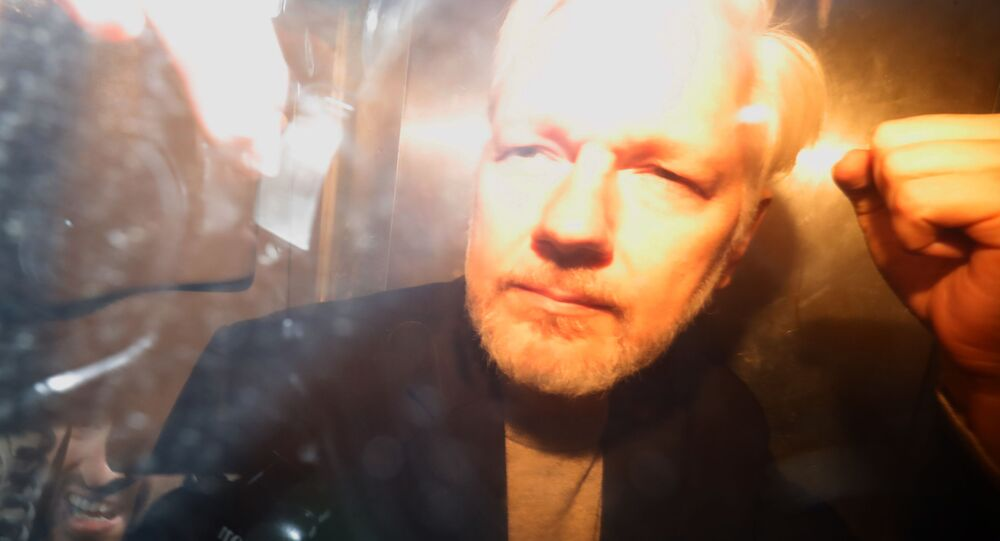 Julian Assange charged with conspiring with