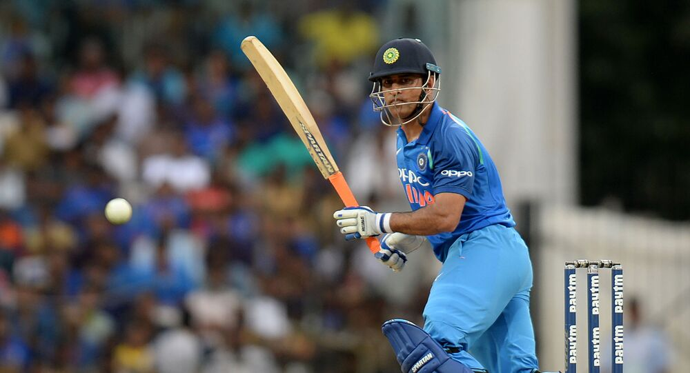 Indian cricketer Mahendra Singh Dhoni plays a shot during the first one day international (ODI) cricket match in the India-Australia series at the M A Chidhambaram stadium in Chennai on September 17, 2017