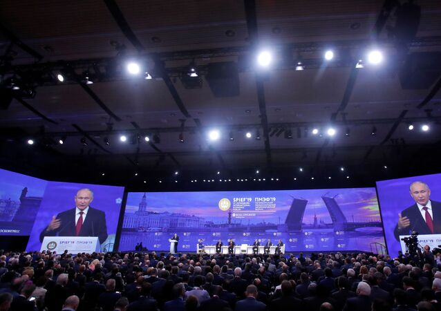 Participants listen to Russian President Vladimir Putin, who delivers a speech during a session of the St. Petersburg International Economic Forum (SPIEF), Russia June 7, 2019