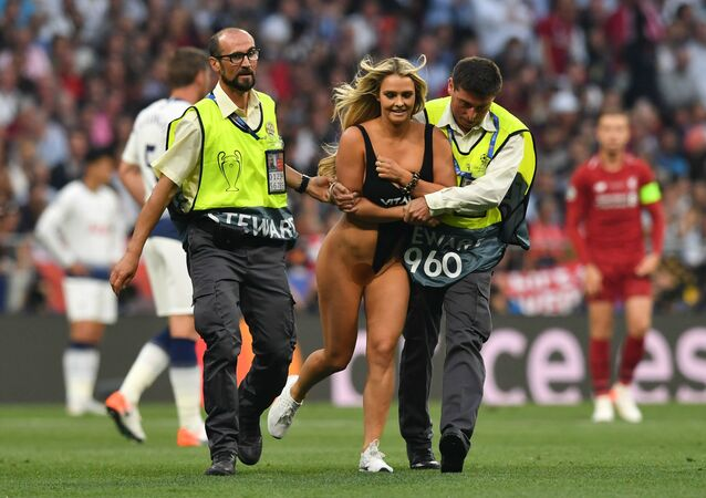 Security escort a pitch invader during the UEFA Champions League final football match between Liverpool and Tottenham Hotspur at the Wanda Metropolitan Stadium in Madrid on June 1, 2019