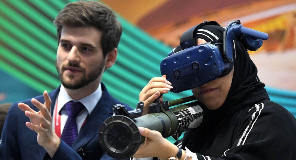 SPIEF 2019 visitor in the HTC Vive VR headset