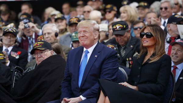 President Donald Trump and first lady Melania Trump, participate in a ceremony to commemorate the 75th anniversary of D-Day at the American Normandy cemetery, Thursday, June 6, 2019, in Colleville-sur-Mer, Normandy, France. - Sputnik International