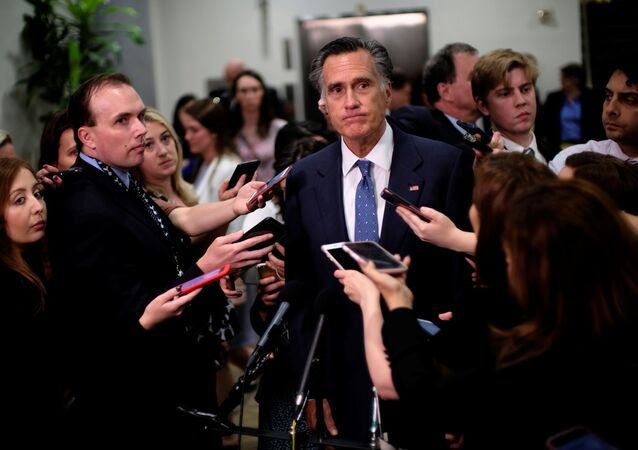 US Senator Mitt Romney (R-UT) speaks to reporters after being briefed on Iran by the Secretary of State and acting Defense Secretary on Capitol Hill in Washington